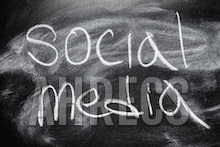 The word Social Media written in chalk on a blackboard.