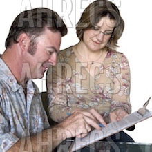 A young woman helping a man complete a survey