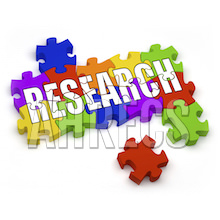 The word RESEARCH written in large letters written across a multi-coloured jigsaw