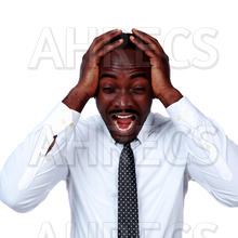 A screaming african businessman shouting and closing ear by his hands, isolated on white background