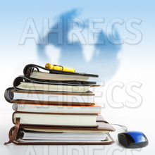e learning- A stack of reference books with a mouse attached in front of a globe