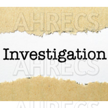 The word 'Investigation' seen through a tear of brown paper.
