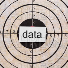The word Data written on a card placed at the centre of a shooting target.