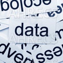 The word data written on a card resting on a pile of other cards/words
