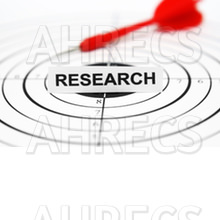 Dart rests atop a shooter target. At the centre of the target is a card that has the word RESEARCH written on it