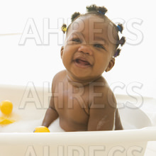 Grinning baby baby in bubble bath