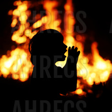 Kid calling for help silhouetted in front of wildfire
