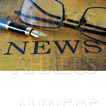 News written on old paper, with a fountain pen and spectacles