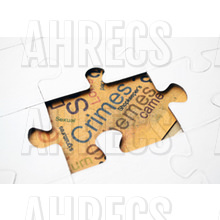 White jigsaw with crime and related words visible through a gap