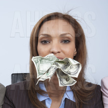 Woman with cash in mouth