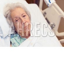Senior woman in a high-low bed looking depressed