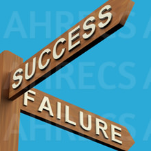 Wooden signpost point to success or failure