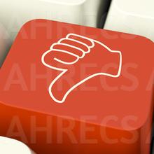 Thumbs Down Icon on a computer keyboard key. Metaphor for dislike, failure or false