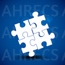 Four white jigsaw pieces attached in a diamond shape on a blue background