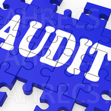 The word Audit written across a jigsaw puzzle