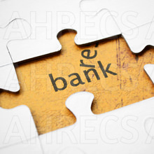 "The word ""bank"" viewed through an opening in a jigsaw puzzle"
