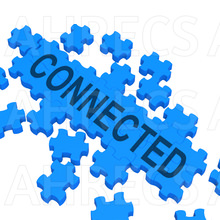 The word 'Connected' written across a partially complete jigsaw puzzle