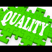 The word 'Quality' written across a jigsaw puzzle