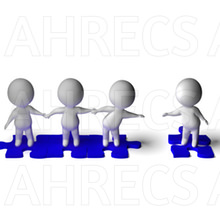 A line of 3d figures stood on jigsaw puzzle pieces holding hands wth one at the end separated and trying to reach out to the others