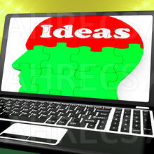 The word 'Ideas' on brain comprised of jigsaw pieces ween on a laptop screen