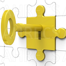 Key In a lock of a wall of jigsaw pieces