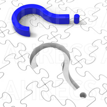 Coloured 3d question-mark resting on a blank white jigsaw puzzle with an empty slot for the question-mark
