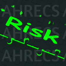 The glowing word Risk on a black jigsaw puzzle piece with a neon edge