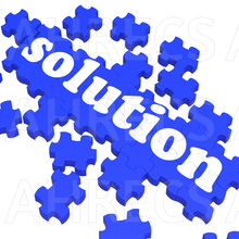 The word/ 'solution' on a compiling jigsaw puzzle.