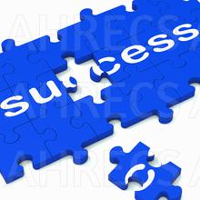The word Success written across a jigsaw