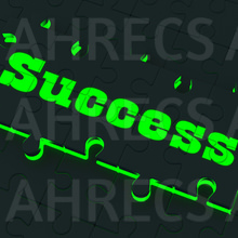 The word 'Success' written in glowing letters on a black jigsaw puzzle piece with glowing edges.