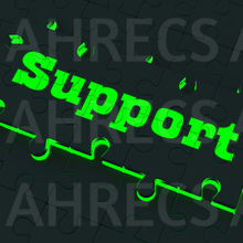 "Glowing puzzle bears the word ""Support"" in glowing letters"