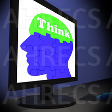 The word 'Think' written on a human head/brain jigsaw puzzle seen on a monitor
