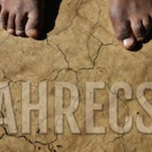 Black feet on sunburnt earth