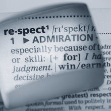 A dictionary entry for the word 'Respect' seems through a small lensing material