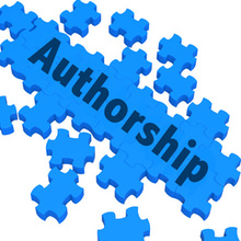 "The word ""Authorship"" written across a partially completed jigsaw puzzle"