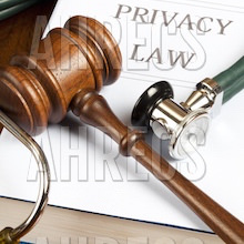 """Stethoscope and gavel resting on a book with """"PRIVACY LAW"""""""