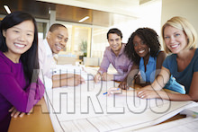 A happy diverse group at a meeting table