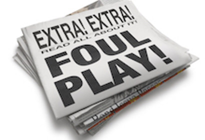 "Folded newspaper isolated on a blank background with the words ""FOUL PLAY!"" as the front cover headline"