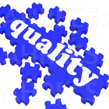 The word 'Quality' on a dark blue partially completed puzzle
