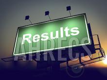 """A lit motorway board with """"Results"""" written across it"""