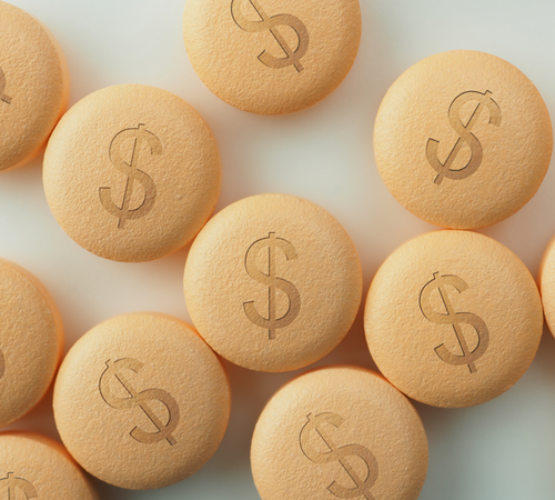 A collection of pills with dollar signs printed on them