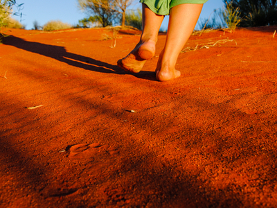 Footsteps in red earth.