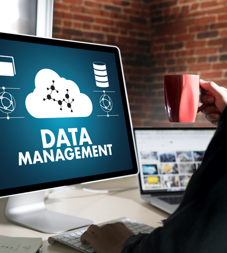 "The words, ""Data Management"" on a computer monitor"