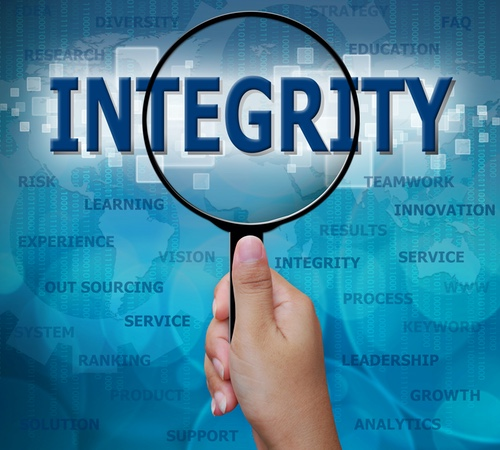 """The word """"INTEGRITY"""" viewed through a magnifying glass"""