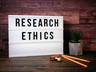 "Noticeboard with the words ""Research Ethics"" written across it."