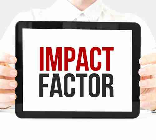 "Man holding a tablet displaying the words ""IMPACT FACTOR"""