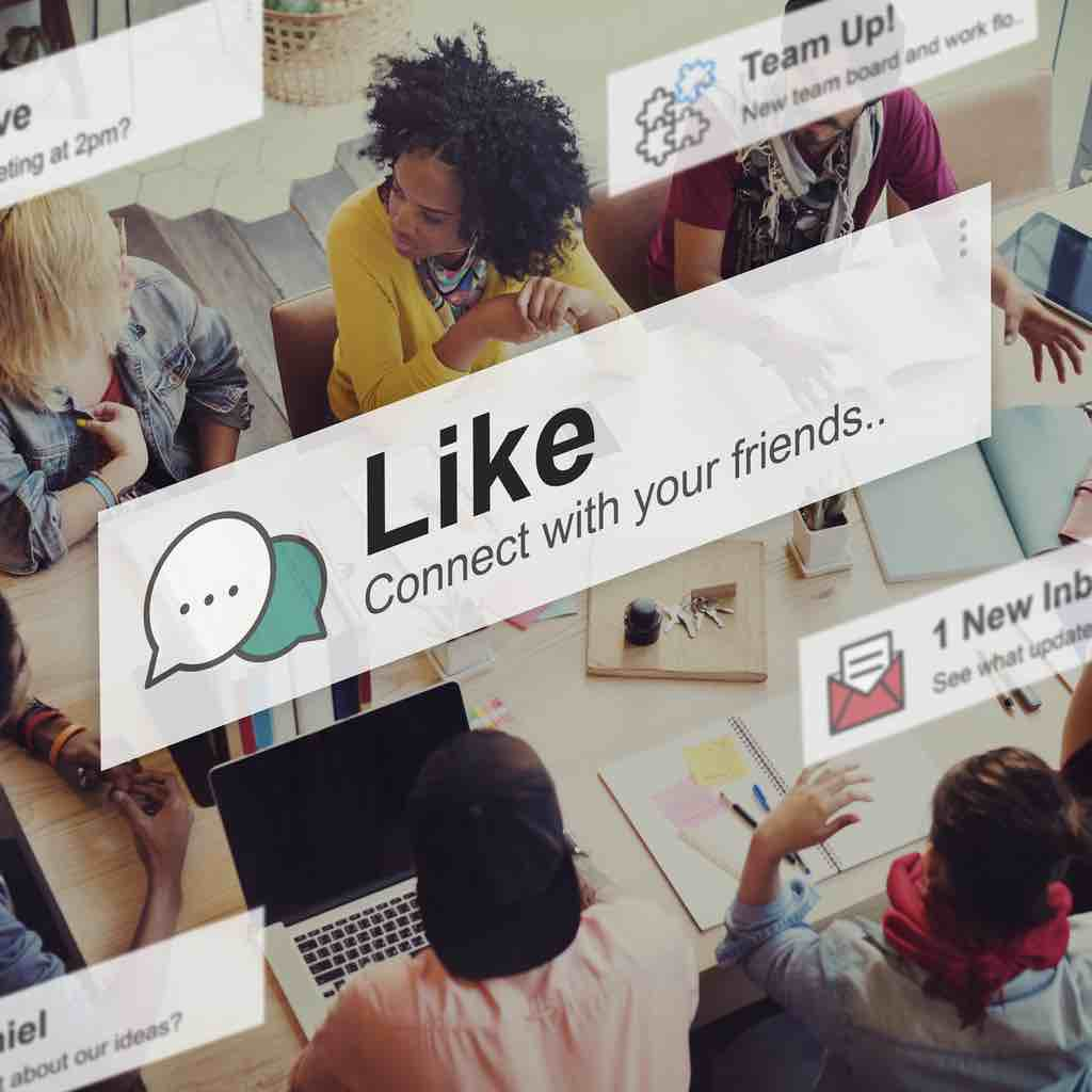 An image looking down on a group of friends liking, sharing and commenting on items