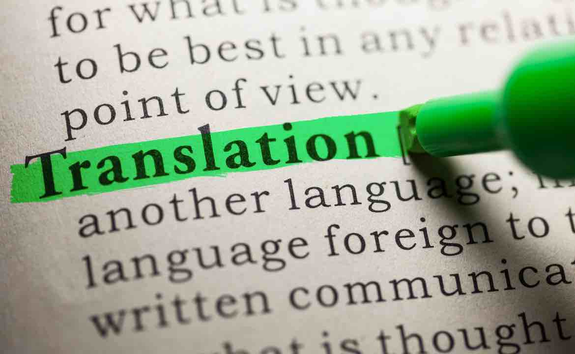 "The word ""Translation"" highlighted by a neon coloured highlighter pen"