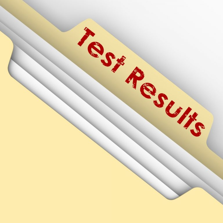 """A full manilla folder with the words """"Test Results"""" written on the tab"""