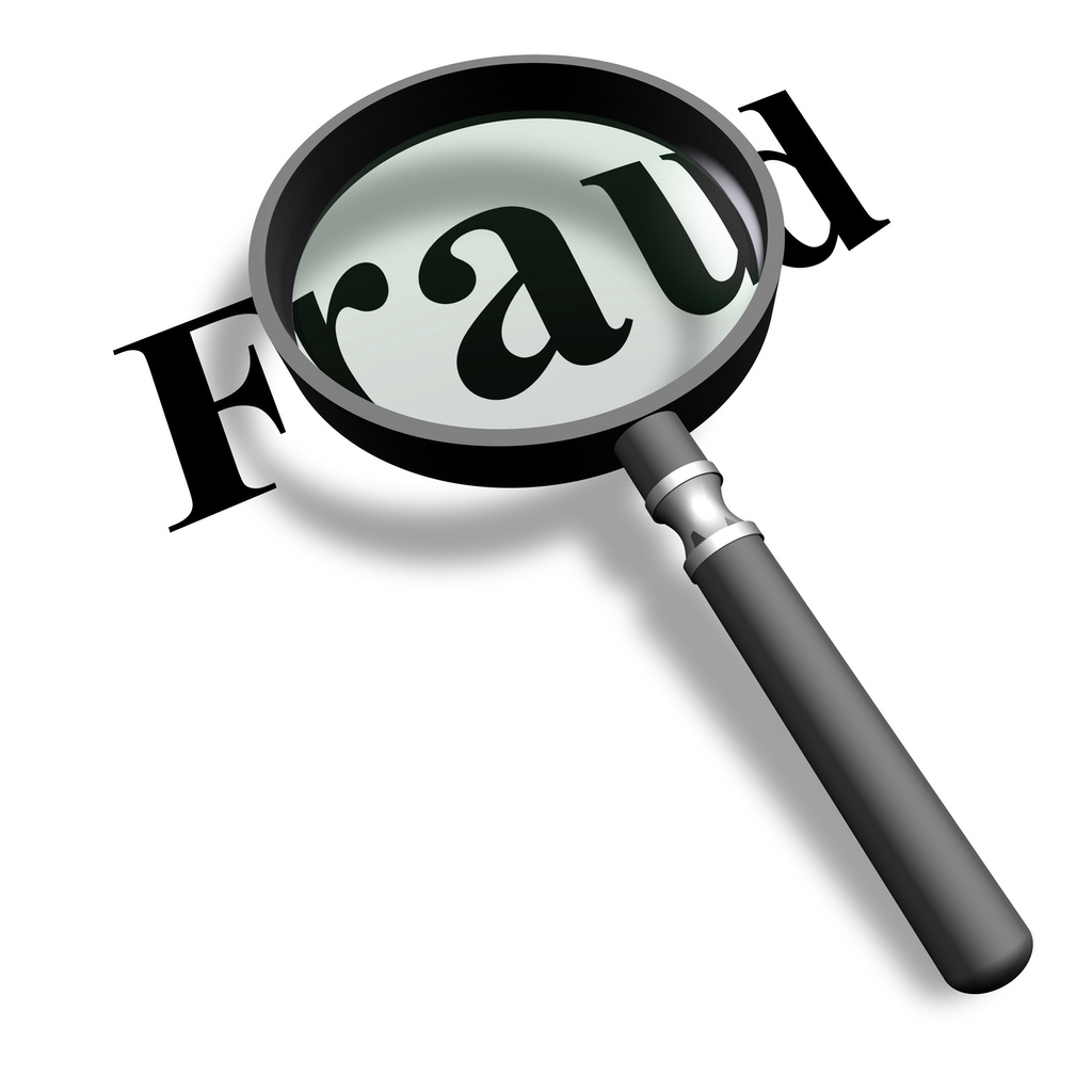 """A magnifying glass focussed on the word """"Fraud"""""""
